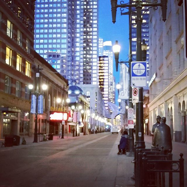 The morning sky begins to lighten over Stephen Avenue in Calgary