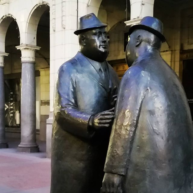 Two statues of businessmen on Stephen Avenue in Calgary