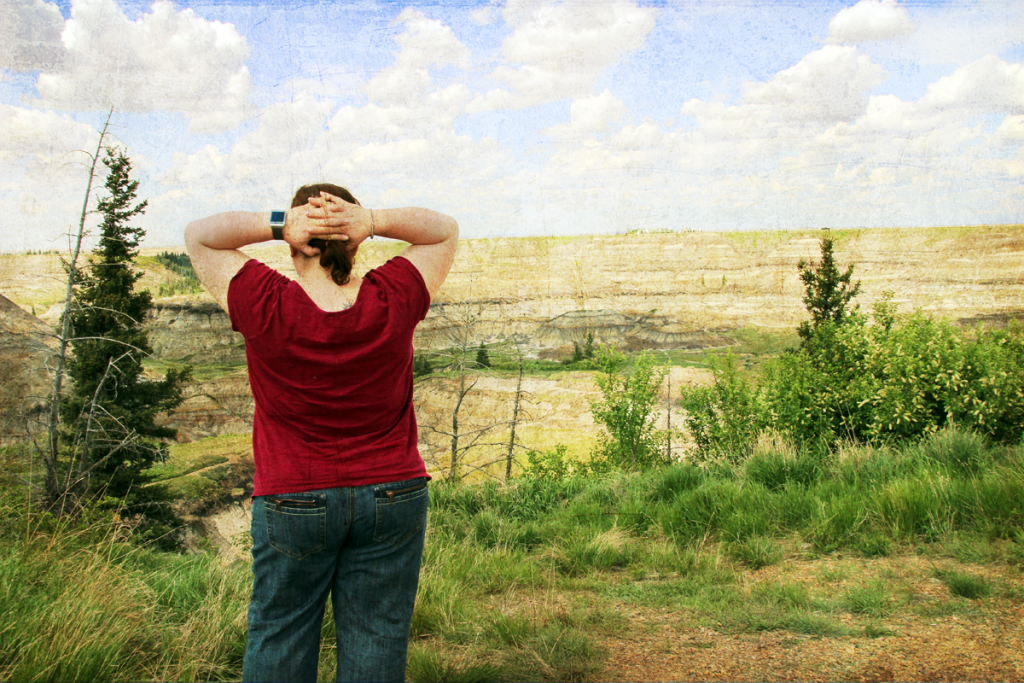 Contemplation of life while overlooking Horseshoe Canyon, Alberta.